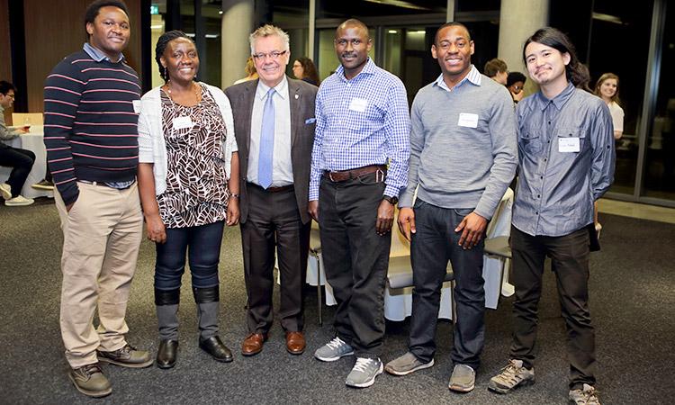 Philip Karangu, Angela Rutakomozibwa, Dean Blye Frank, Hezron Onditi, Aloy Anyichie, and Yuya Takeda at the Education Graduate Student Reception.